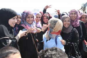 A group of young women give a warm welcome to the delegation.