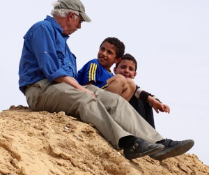 Bob Haynes on a sand hill, talking with local children (photo by Gerri Haynes)