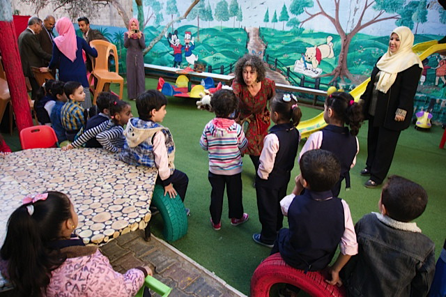 D'vorah Kost with kindergarten children
